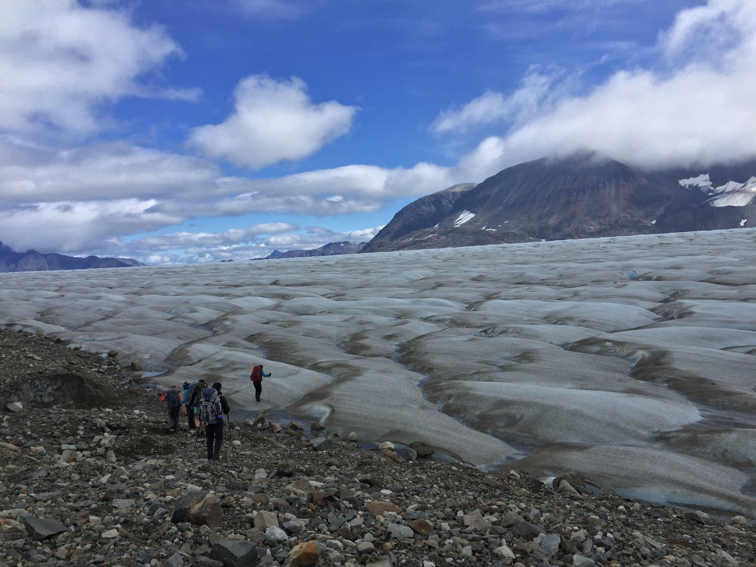 Team BGC crosses from the nunataks to the blue ice of the ablation zone for a day of fieldwork. Photo credit: Auri Clark