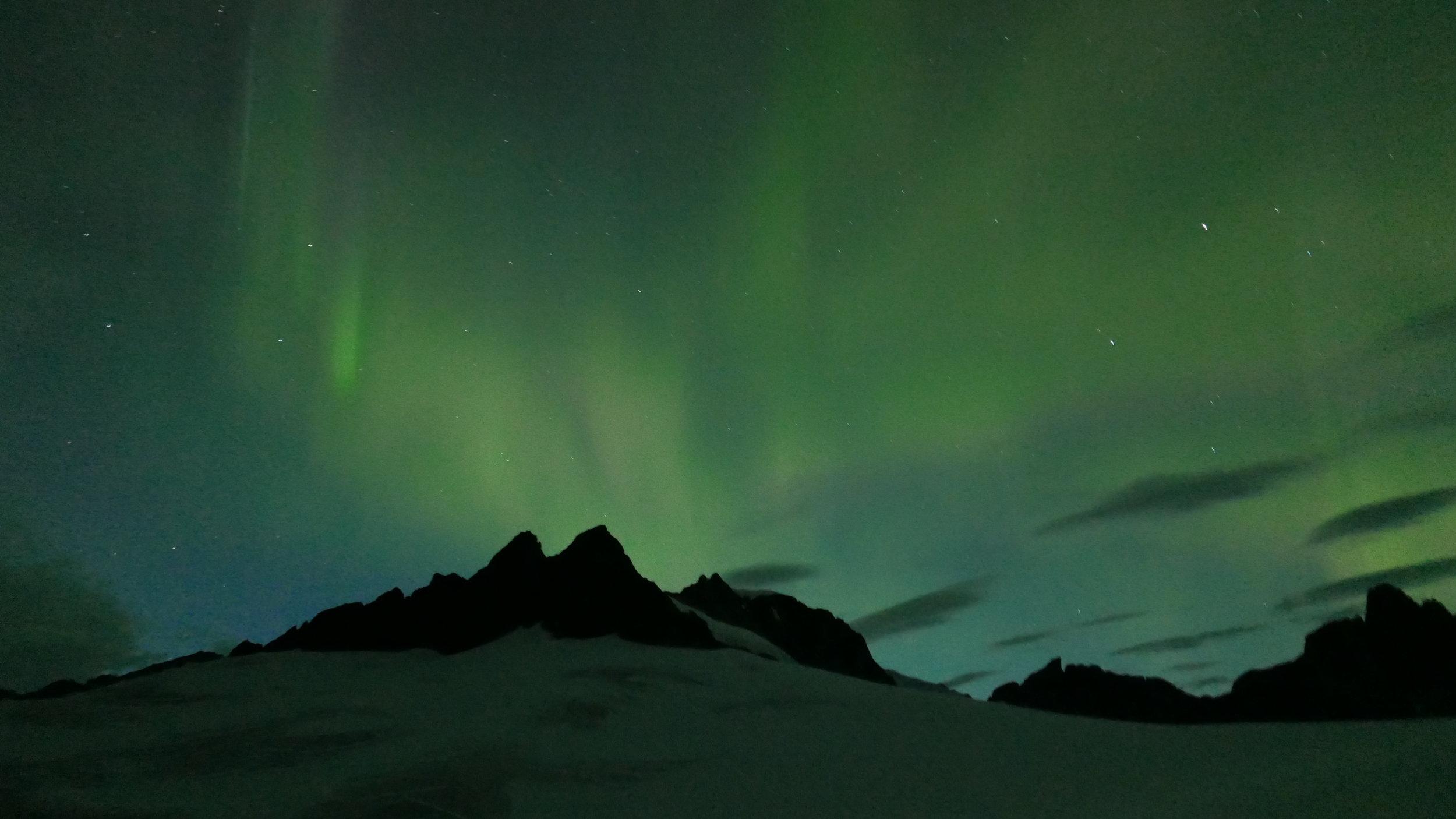 Storm Range at Camp 18 under the Aurora Borealis. Photo Credit: Deirdre Collins