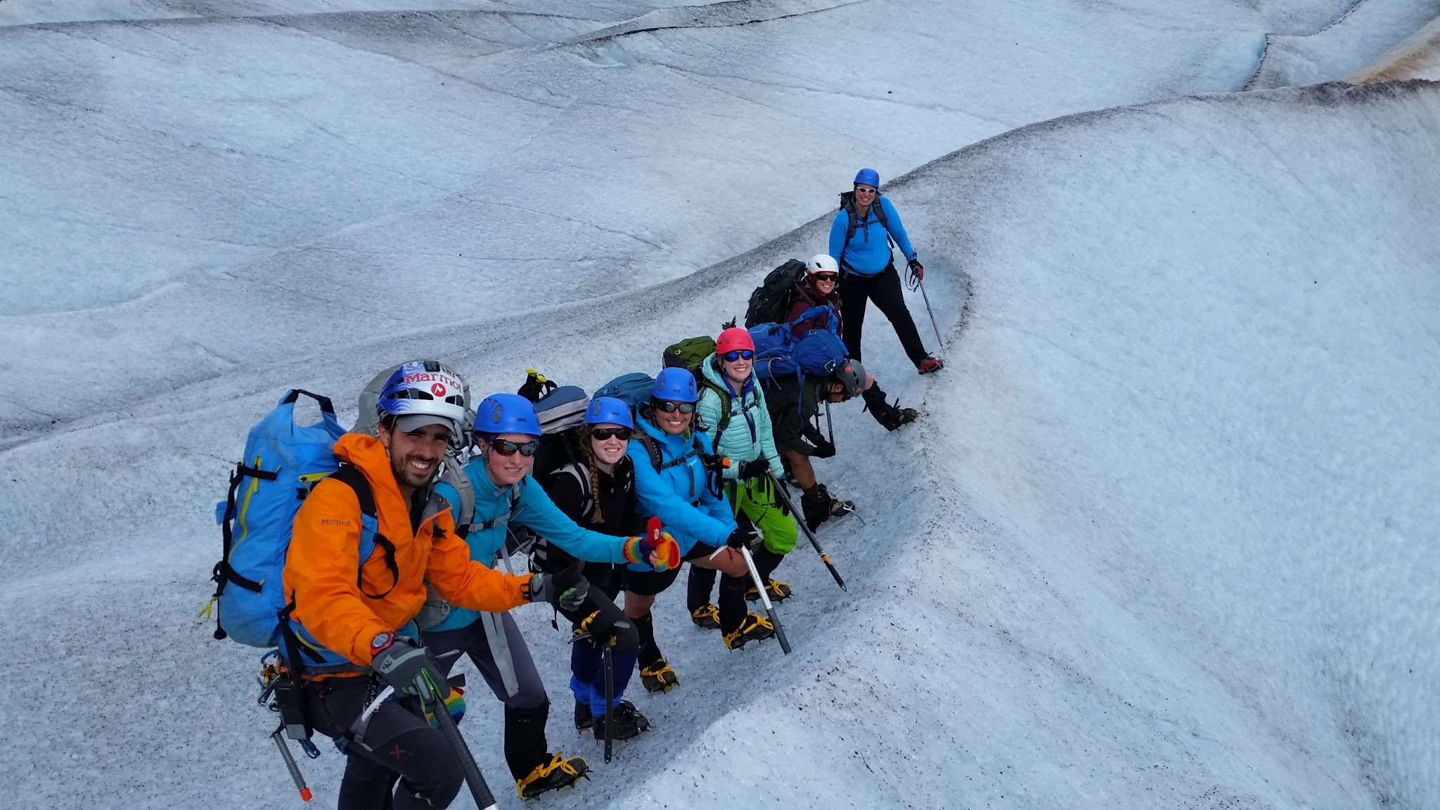 Safety Manager (Ibai Rico, at left) and Executive Director (Erin Whitney, at right) lead crampon practice on the lower Mendenhall Glacier. JIRP 2016. Photo: G. Weary.