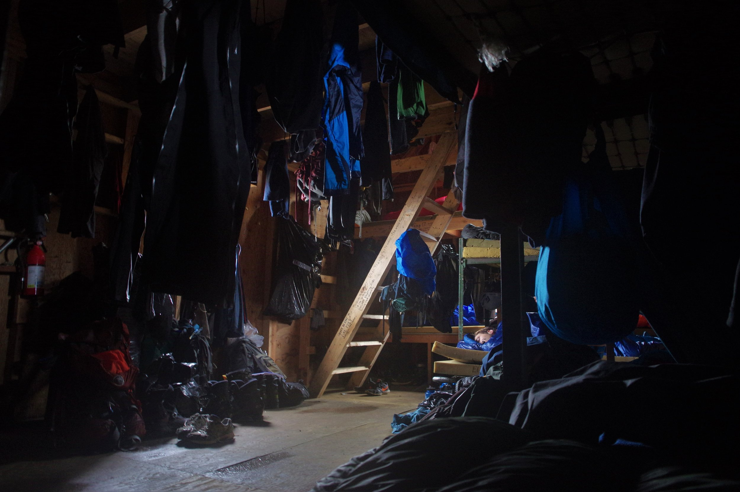The inside of the Armpit, the domain of the male students. Wet gear hanging from the rafters makes for close quarters. Photo: Daniel Otto.