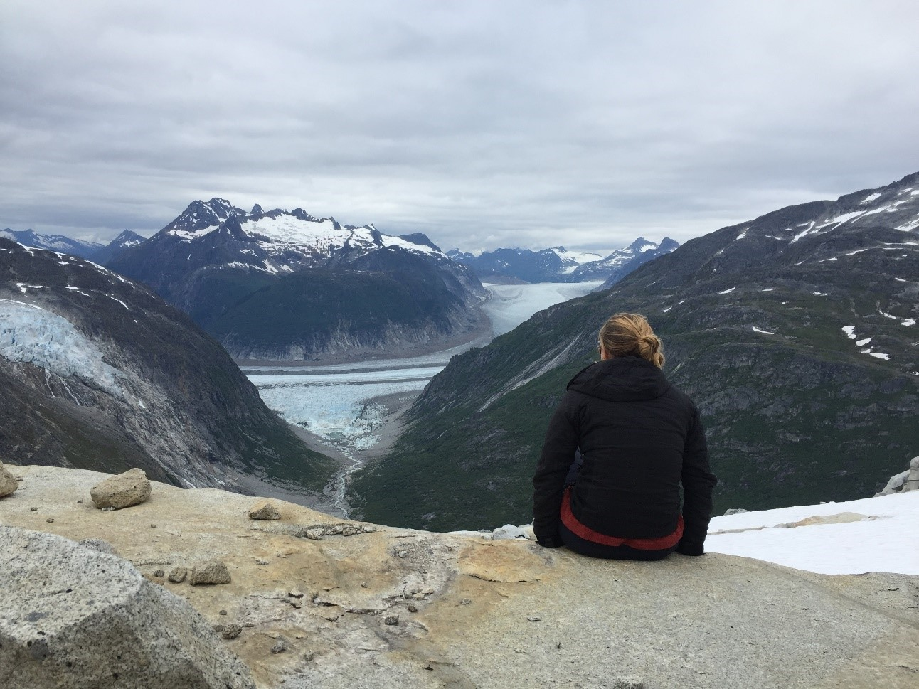 Looking out at the view on the first day. Avalanche Canyon, in the middle ground, is vegetated. In the background the Bucher and Gilkey glaciers flow through the Gilkey Trench and out the left side of the frame. Photo credit: Kara Vogler.