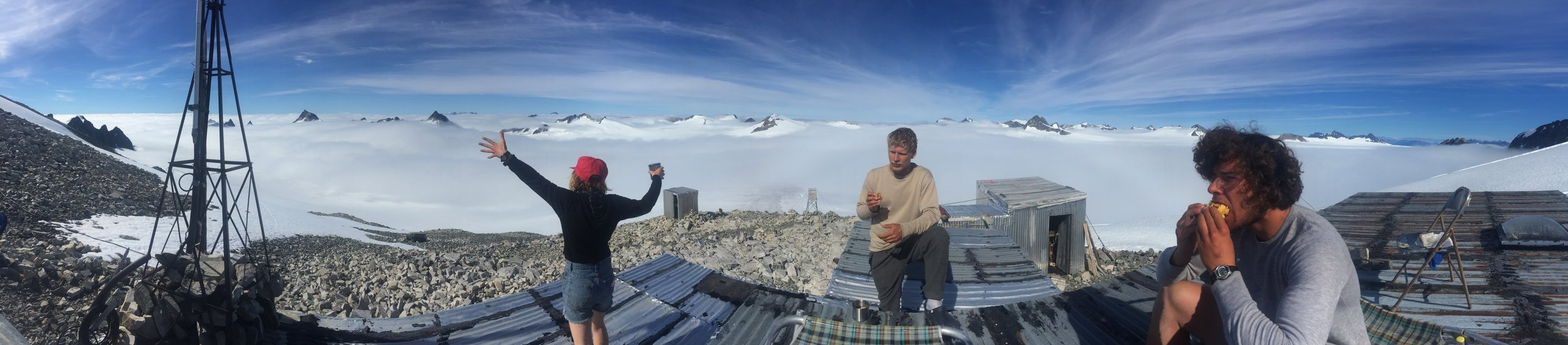 A photographic summary of life at Camp 8: radio, coffee, power stances and waffles atop the roof. From left to right: Danielle Beaty, Bryn Huxley-Reicher, and Avery Stewart. Photo: Amy Towell.