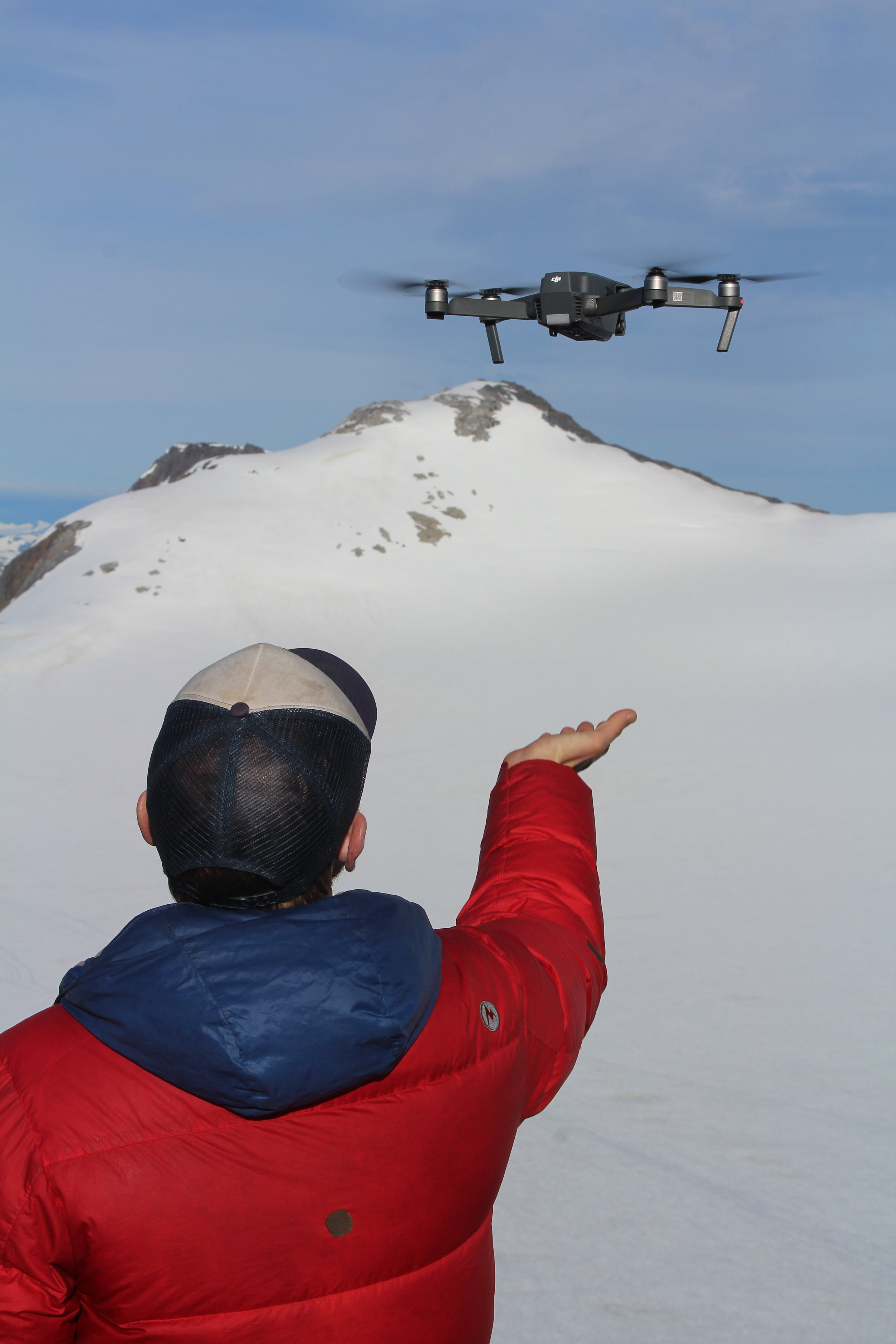 Alum and faculty member Matt Beedle launches a drone over the Lemon Creek Glacier as part of a mini student research project. PC: Evan Koncewicz.