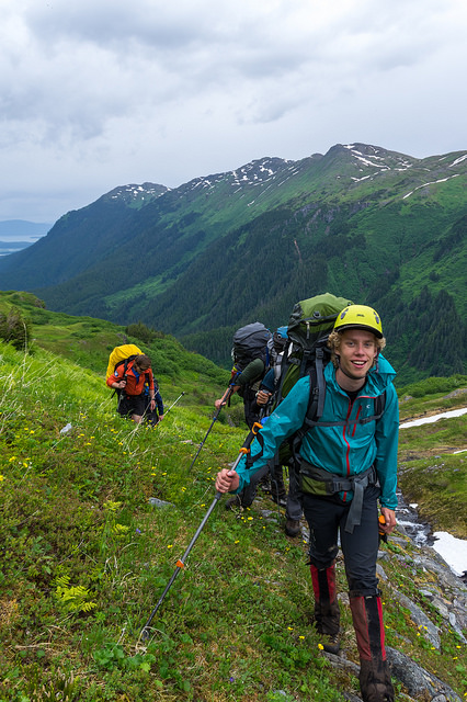 Student Eric Keenan hikes up to Camp 17 with a full size backpack during the first week of JIRP. Check out the mountains in the background- the terrain is steep- but the trail we go up follows a sensible route. PC: Daniel Otto.