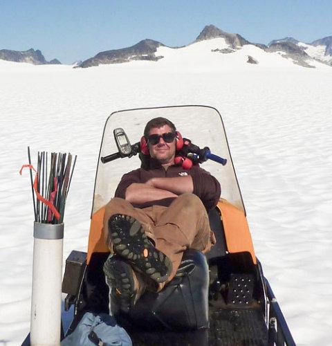 Scott on his trusty steed, Thor the snow machine.