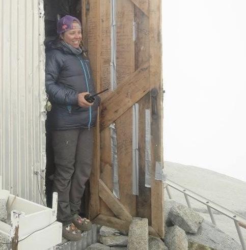 Lara emerges from the Camp 9 Cookshack to make a phone call.