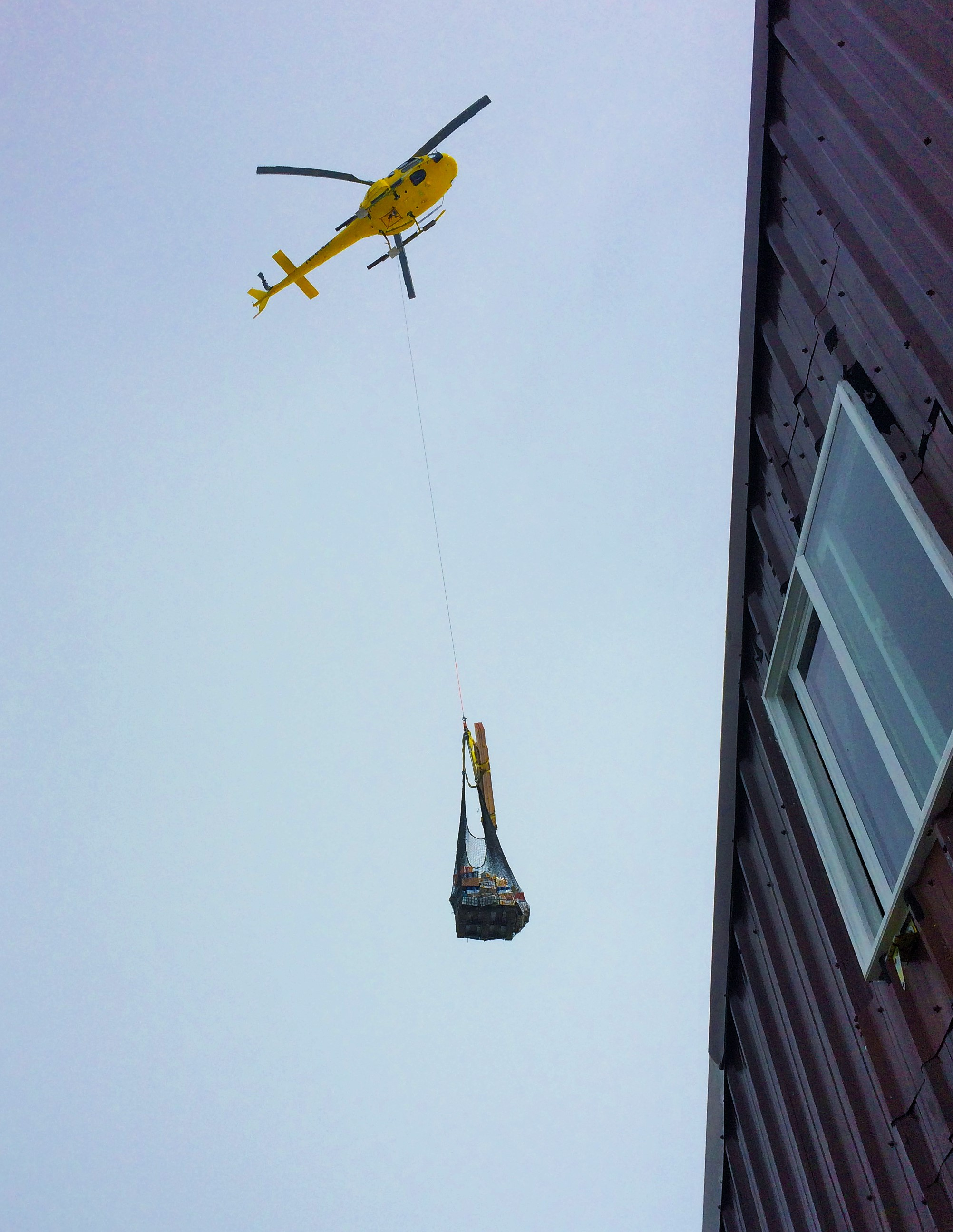 A helicopter bringing in a fresh load of food to help the cooks with their improvisation.