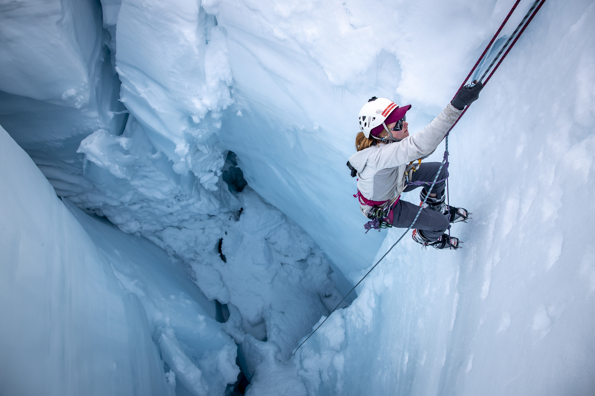 Tori Kennedy climbs out of a crevasse in Alaska. Credit: Andrew Opila