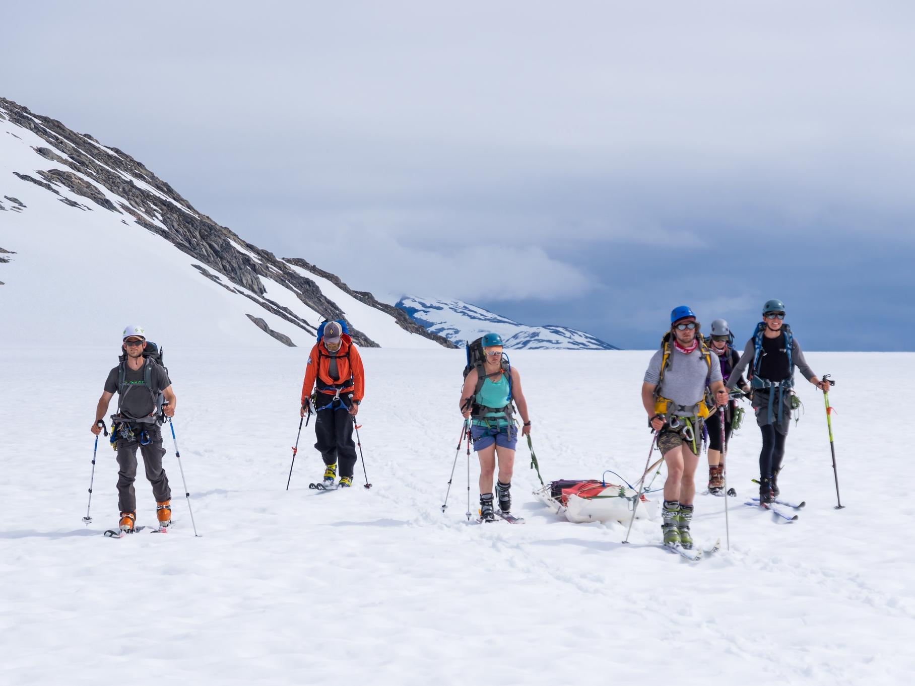 The Geophysics team pulls the Groundpenetrating RADAR across the surface of Taku Glacier. Photo credit: Daniel Otto.