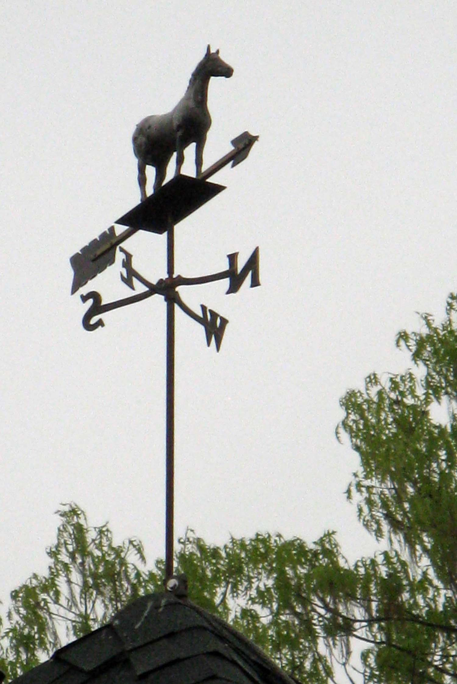 iron horse weathervane atop cupola