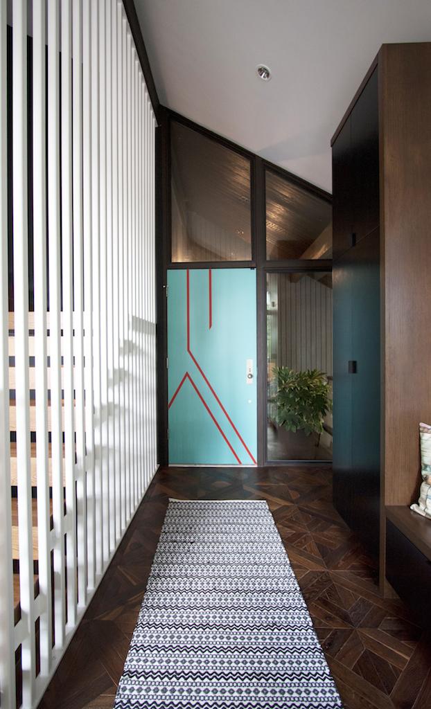 modern entryway with bright front door