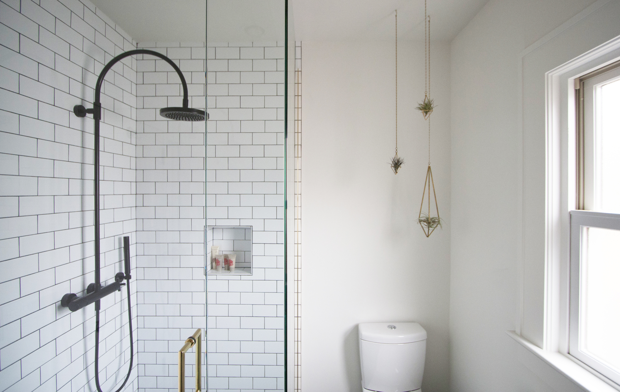 modern bungalow bathroom with brass accents