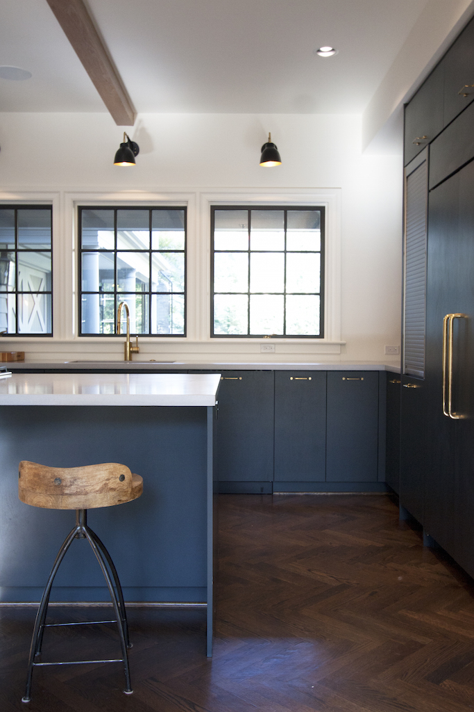 Wood Beam and Grey Cabinets