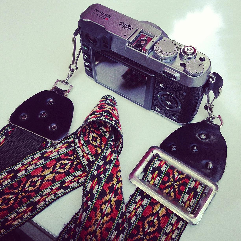 My Fuji X100s with my Dad's genuine 70s camera strap.