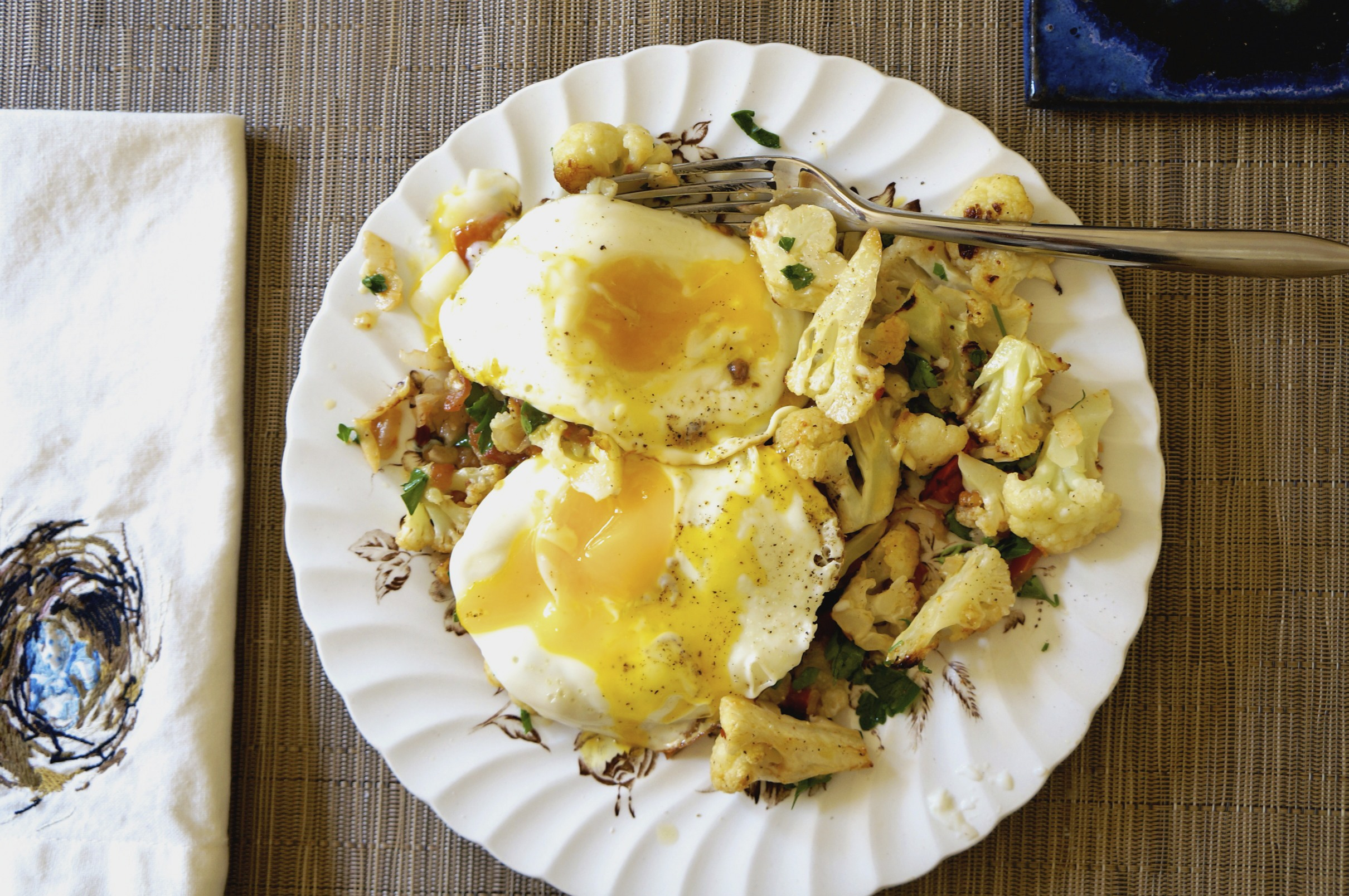 roasted cauliflower with fried eggs via sarahdigrazia.com