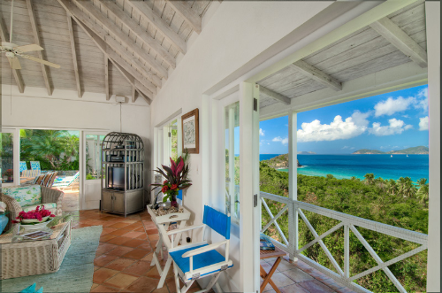 SummerSalt's great room looking out over Smuggler's cove to Gun Point and Jost Van Dyke beyond.