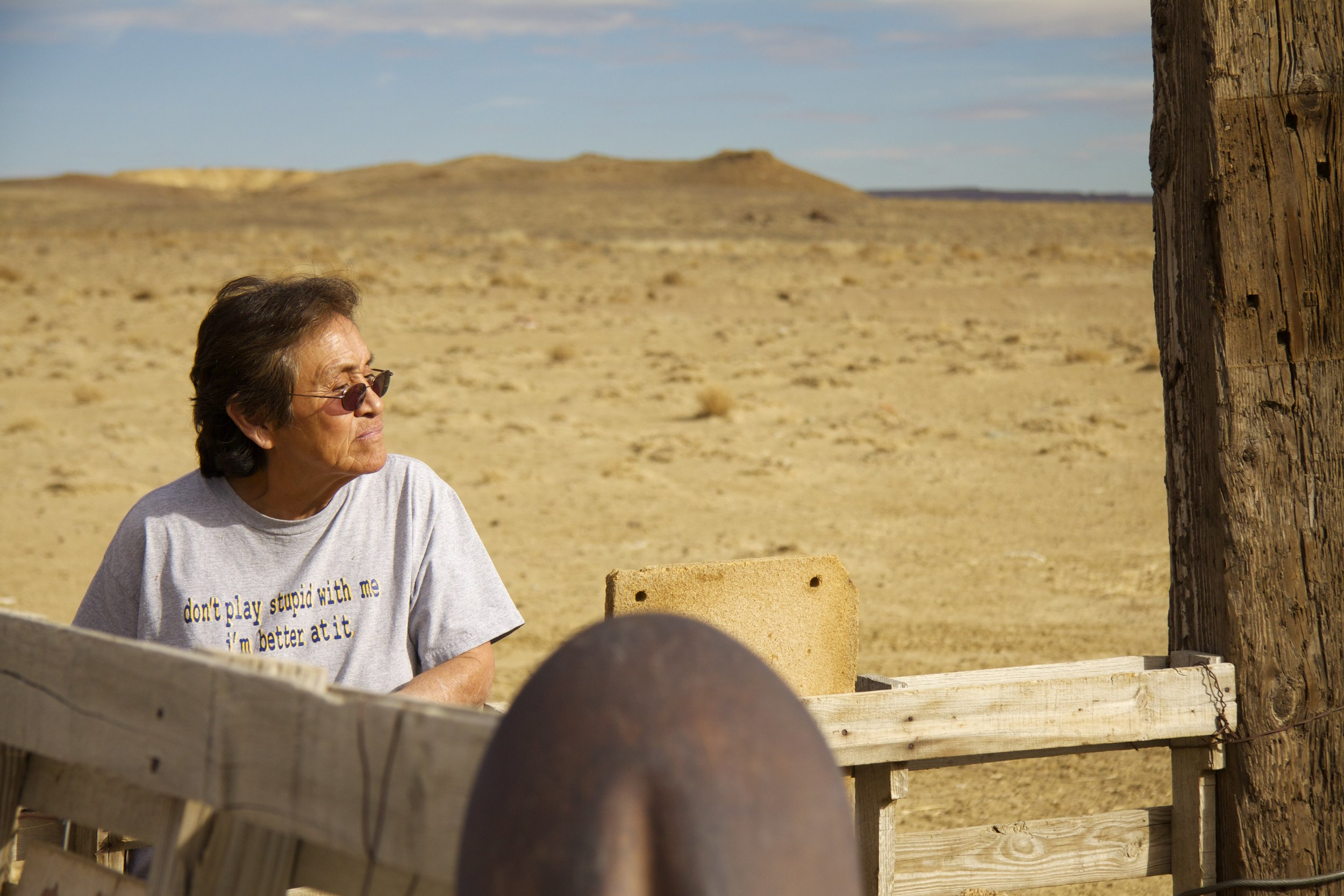 Cindy Dixon stands at her sheep corral near her trailer southeast of Shiprock, N.M.