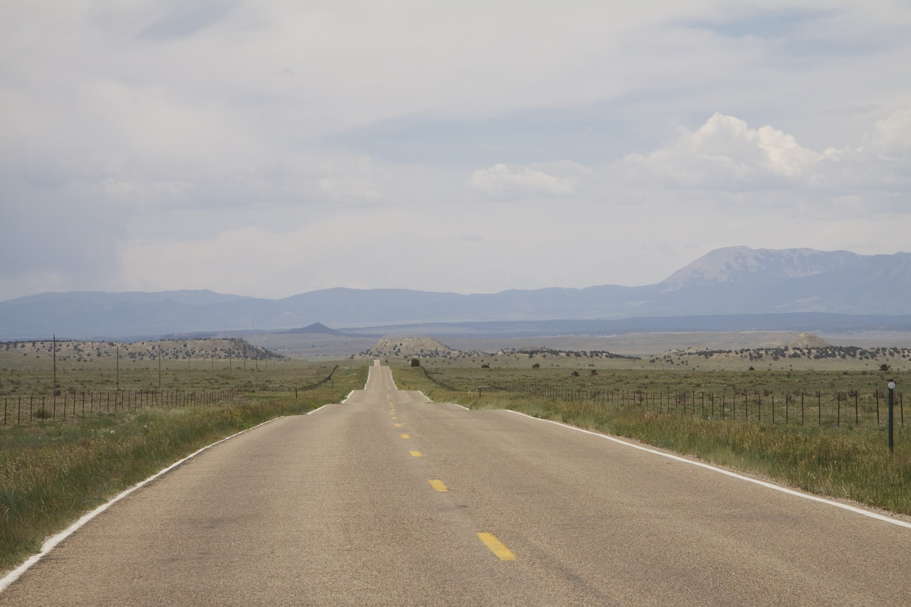 Colorado Highway 10 looking west towards Walsenburg, 13 miles east of I-25. This is not on the list of most scenic highways in the state, but a highway threading through similar country not far to the southeast is on the list. ©2012 by Bobby Magill.