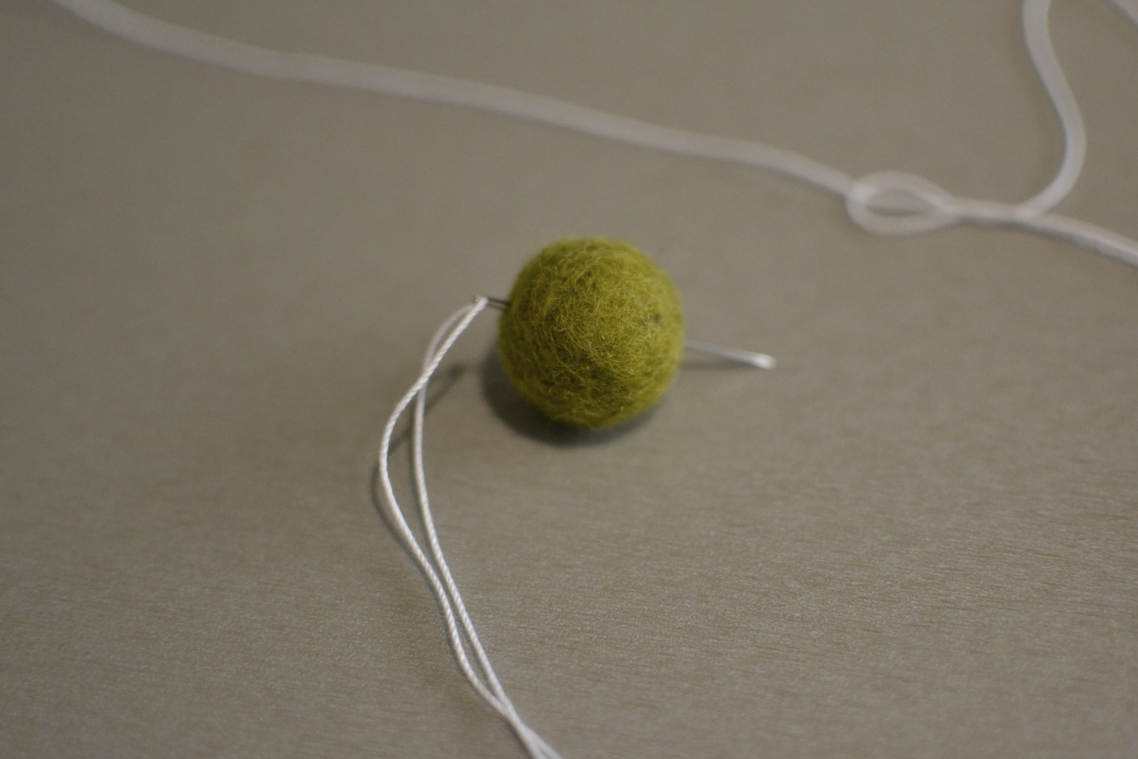 you can, of course, string these up in any pattern and design. i used one felt ball, then one pine cone and so on.