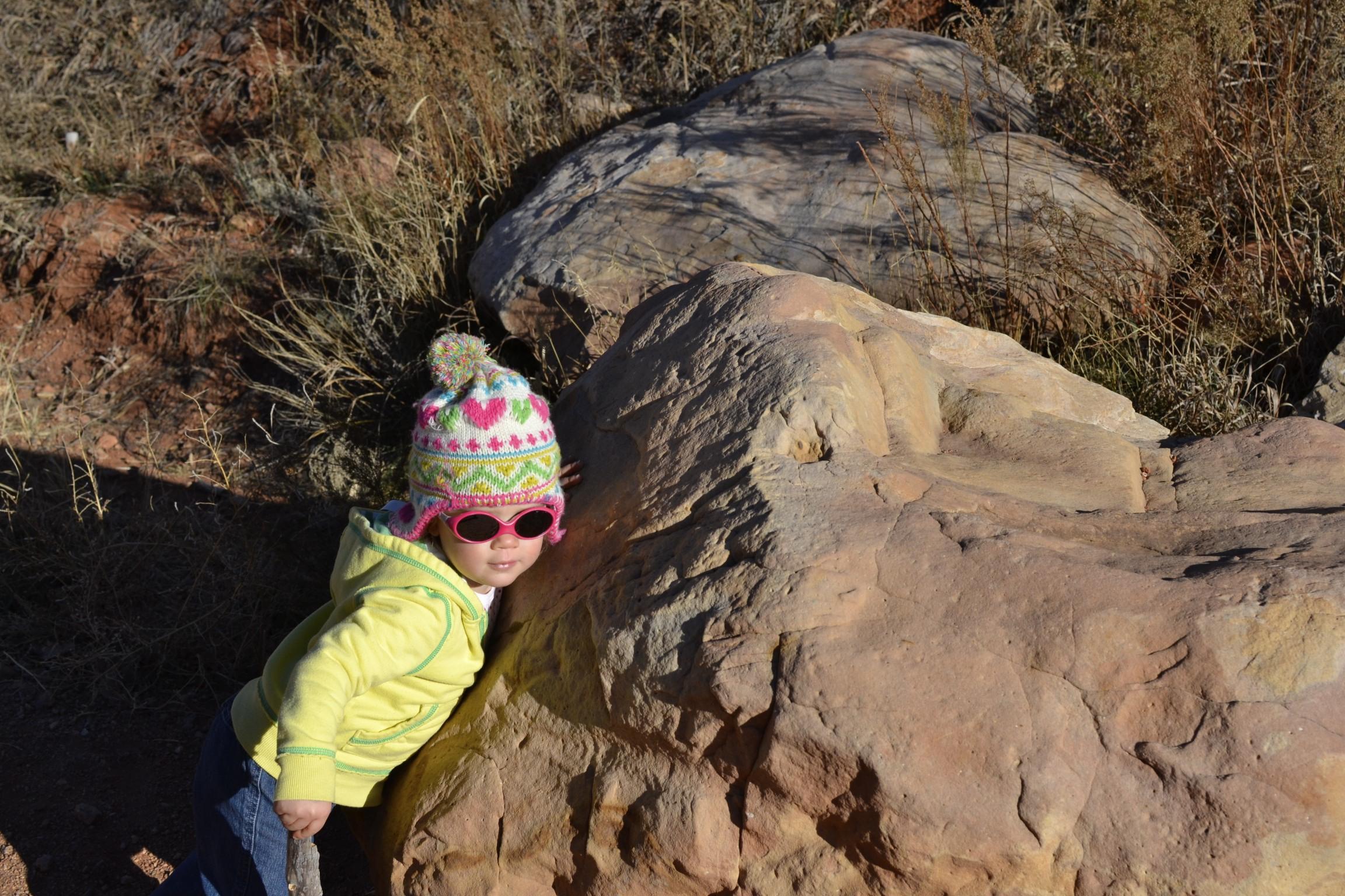 she loves giving hugs...even to rocks.