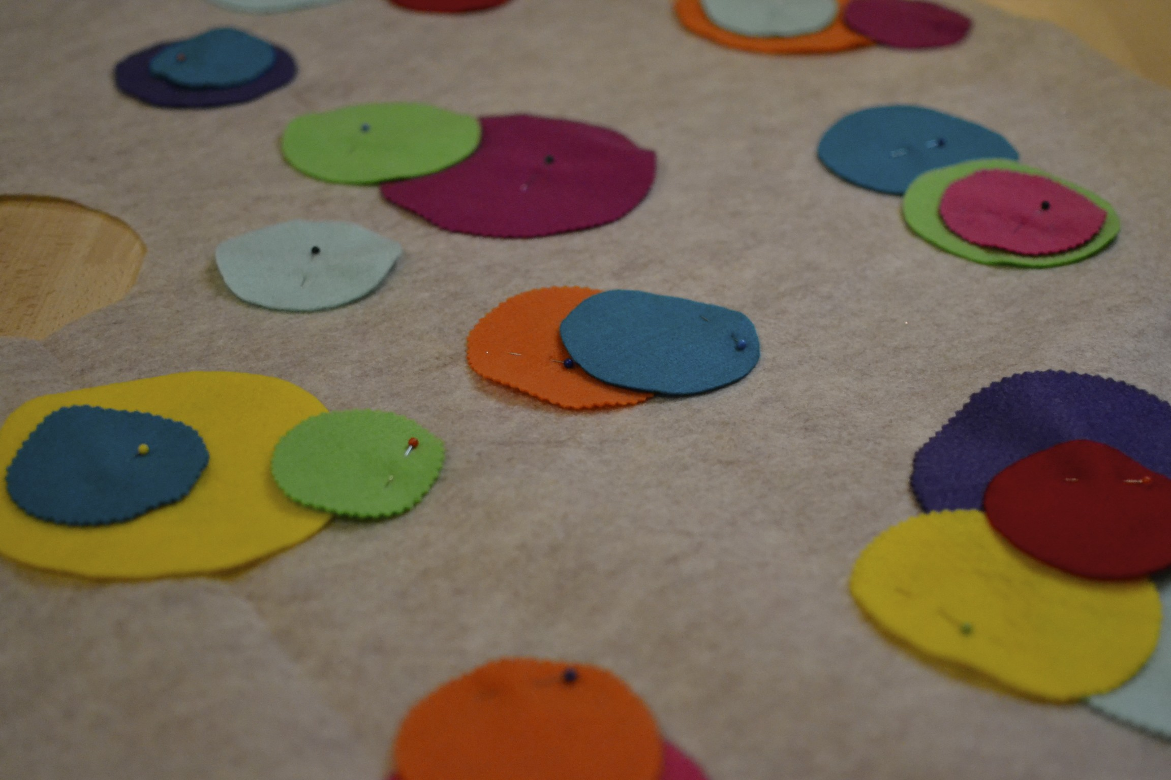 i then randomly laid out the circles, layering some on top of others. once i found a mix that i liked, i pinned everything down into place.