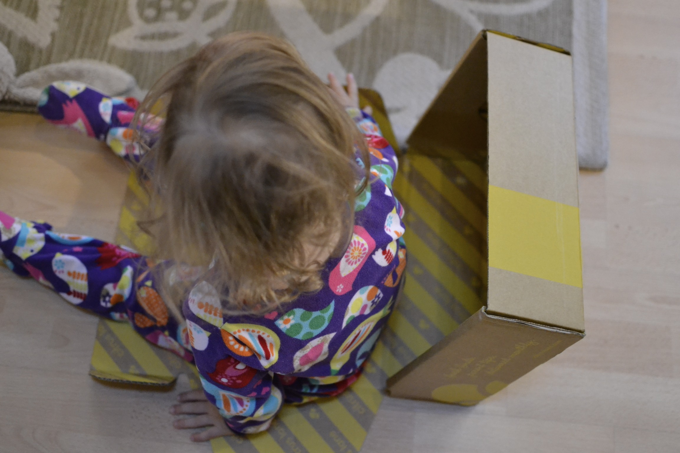 bed head, pjs and playing with boxes