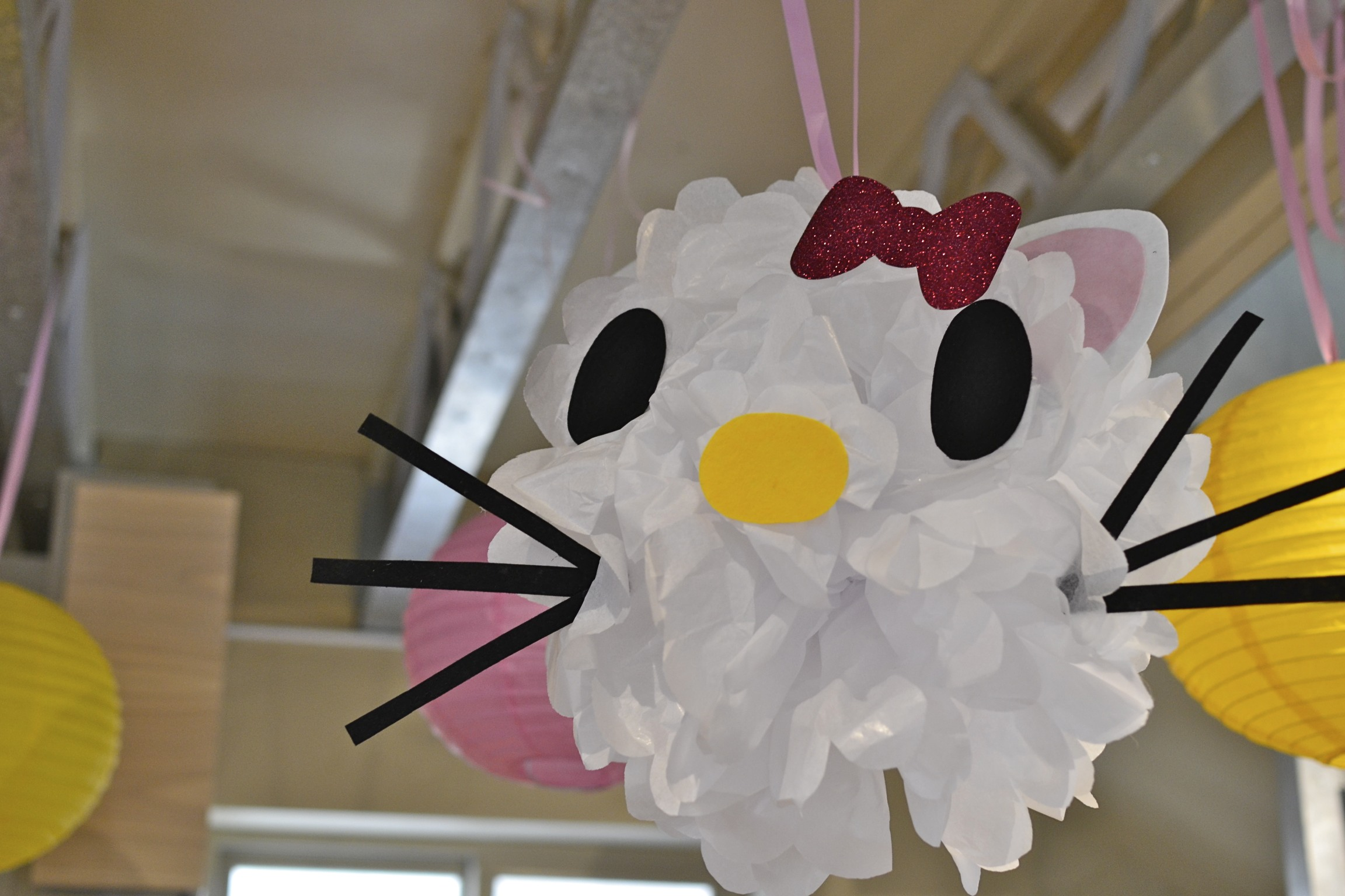 i had so much fun making these hello kitty tissue paper pompoms.  i got the idea from my friend sarah...you can check out the instructions  here .  the eyes on my kitties are a little large but overall, i was pretty excited about how they turned out!