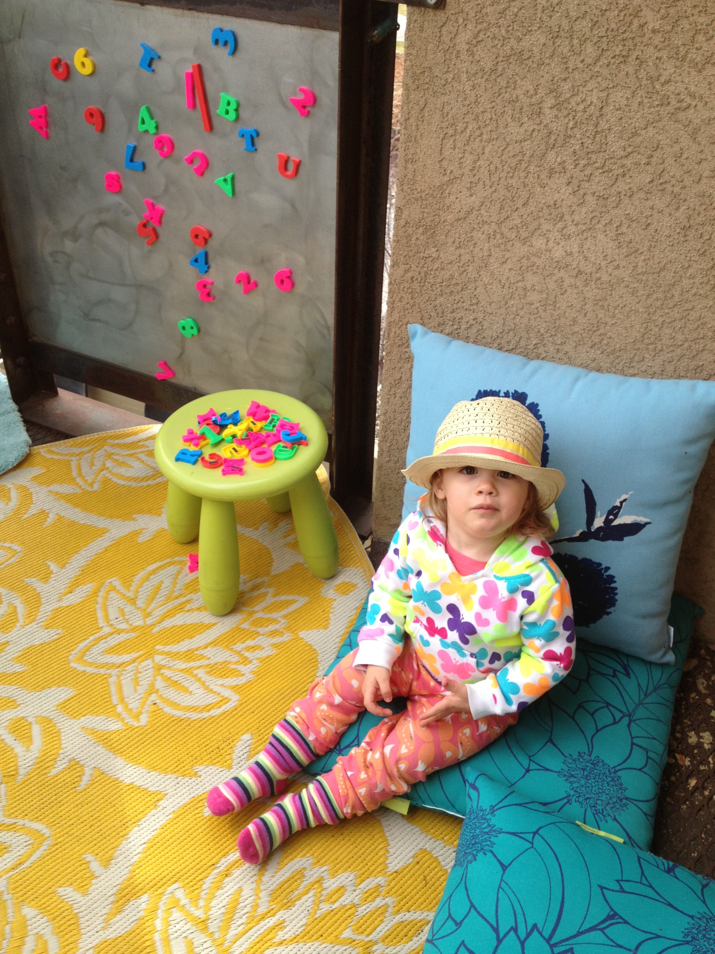 "here's the ""nut"" playing outside on the patio wednesday. it was chilly out so, she picked out her own sweatshirt and put on her own socks and hat to ""add layers"" she told me."