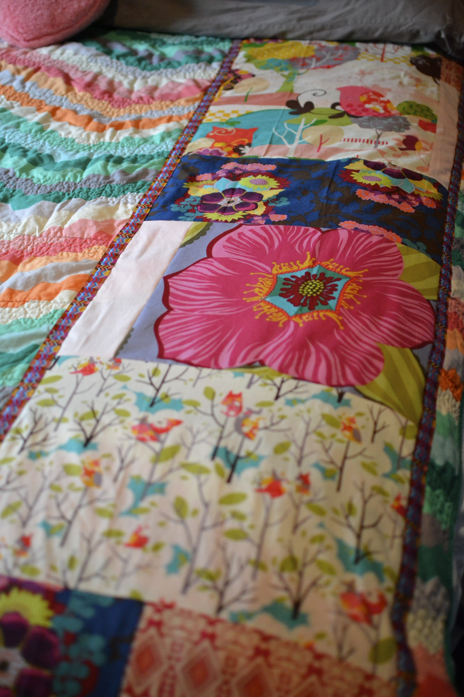 i basically made a long, skinny quilt of the fabrics i liked and then stitched them to the existing quilt. i added an anna maria horner ribbon along each side to finish of the edges.