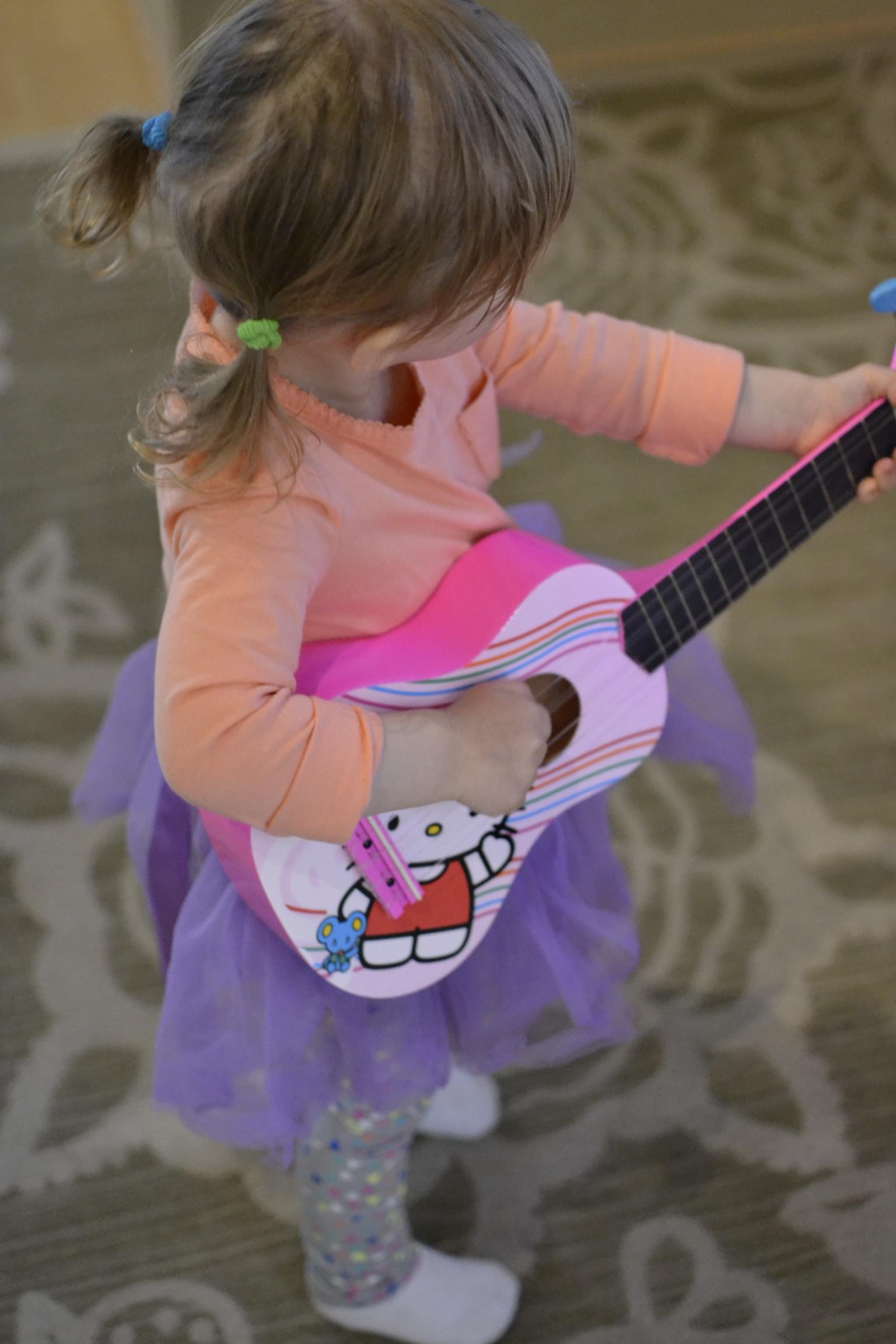purple tutu wearing and guitar playing...