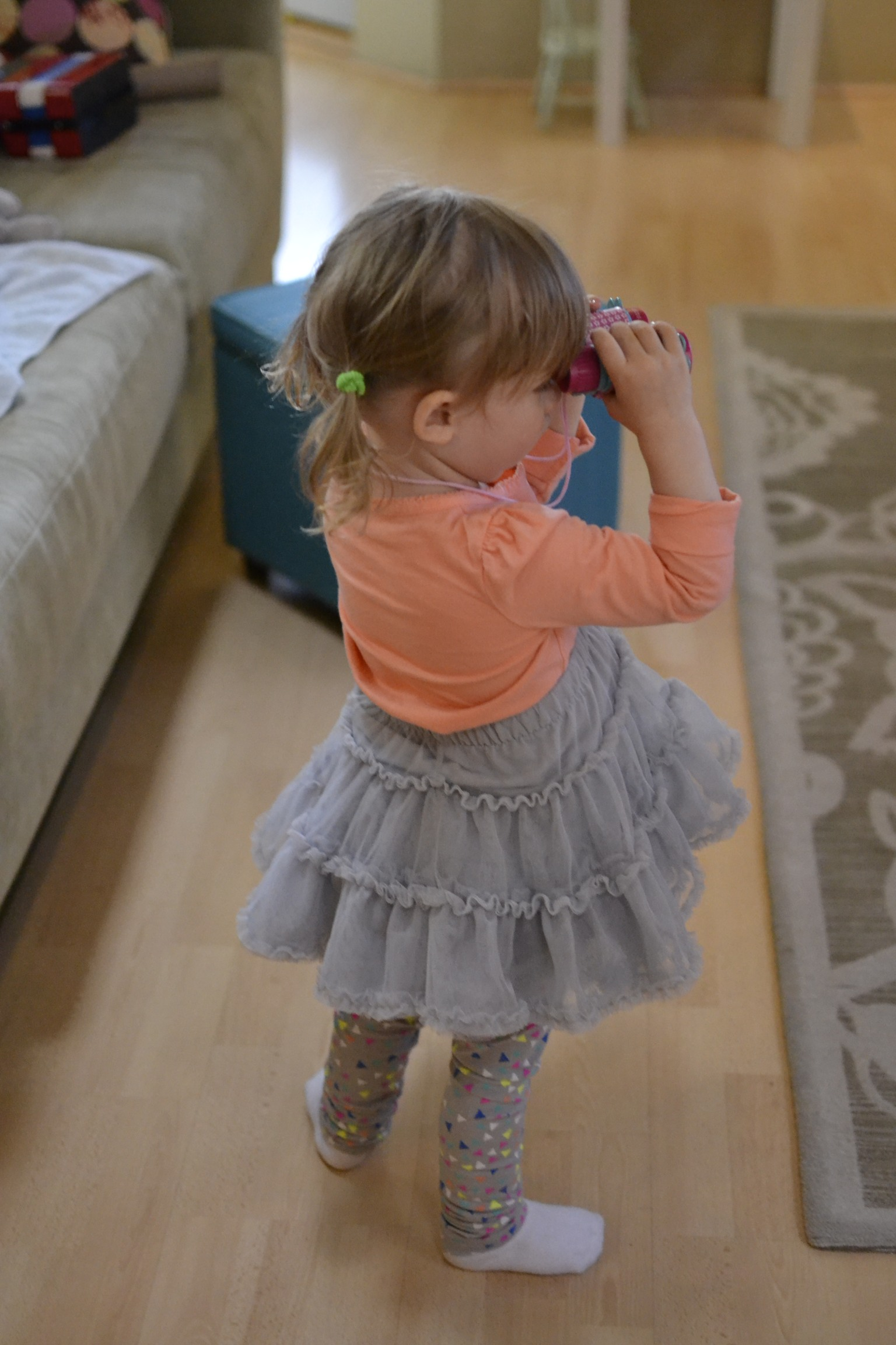 and then, 2 minutes later....deciding the grey tutu was much better.
