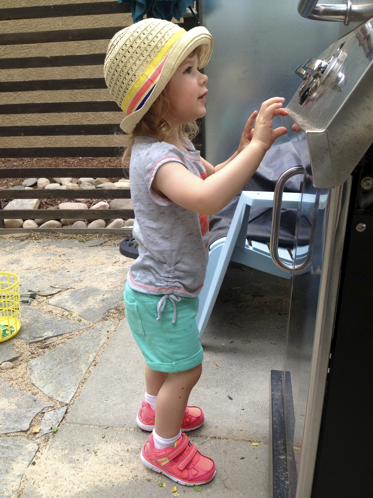 helping daddy grill.  she's a very good helper!