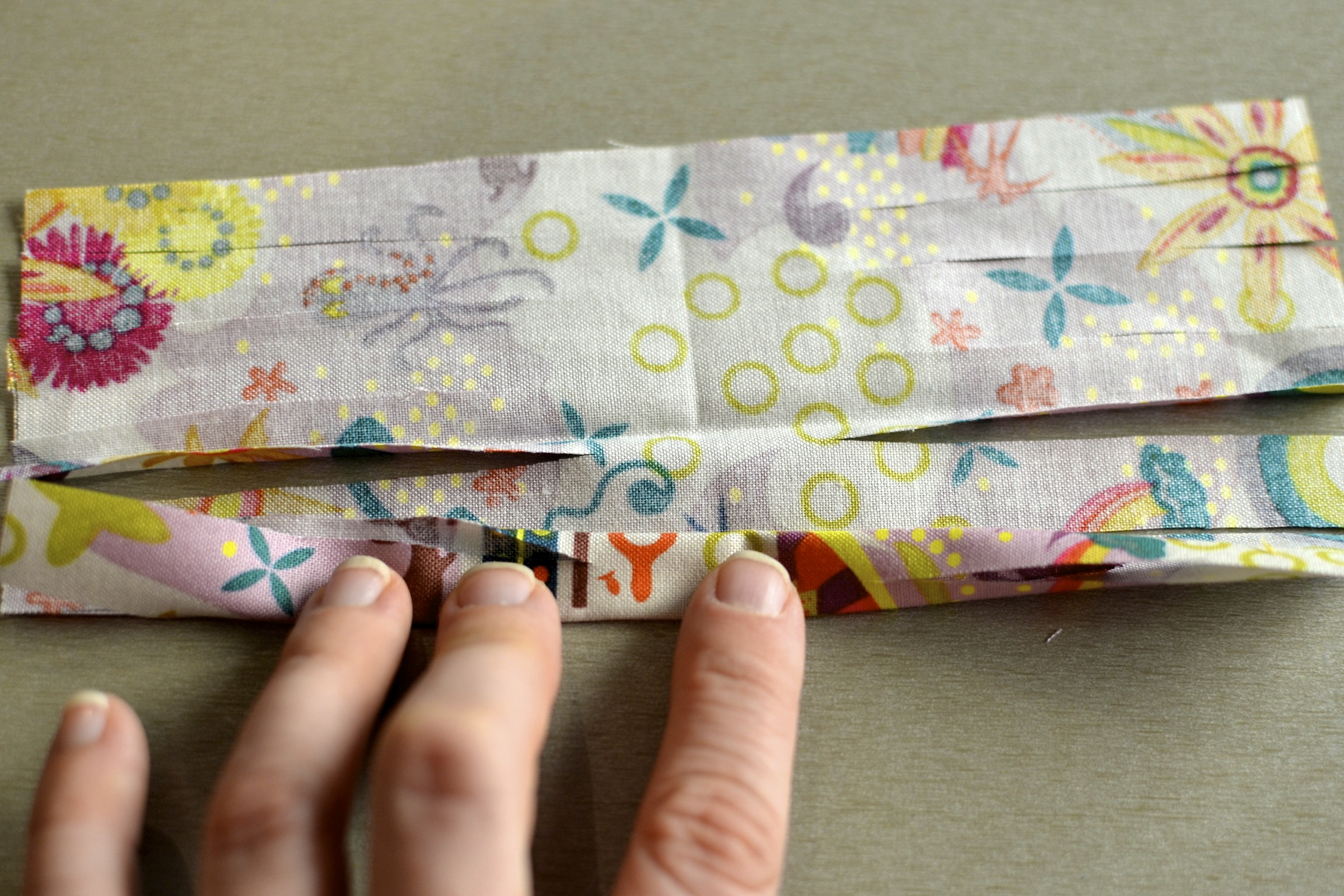 unfold the fabric square and roll/fold it up all the way.