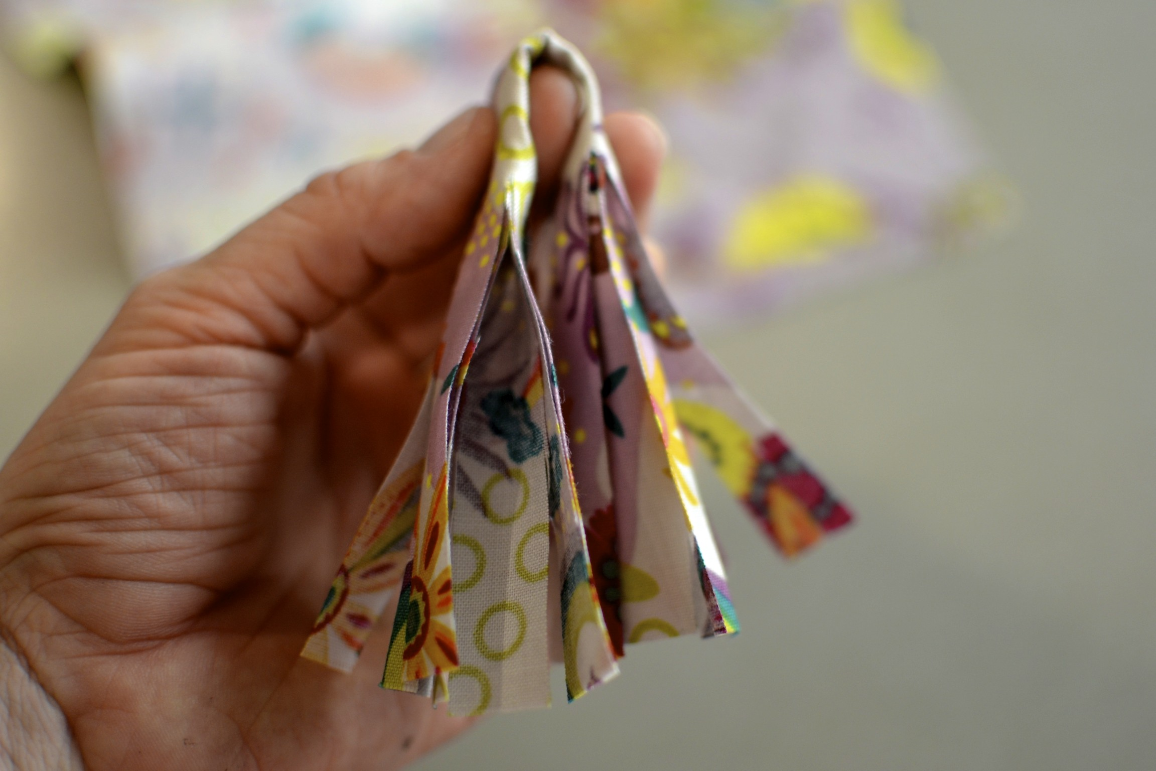 fold the strip in half, where the fabric remains uncut.