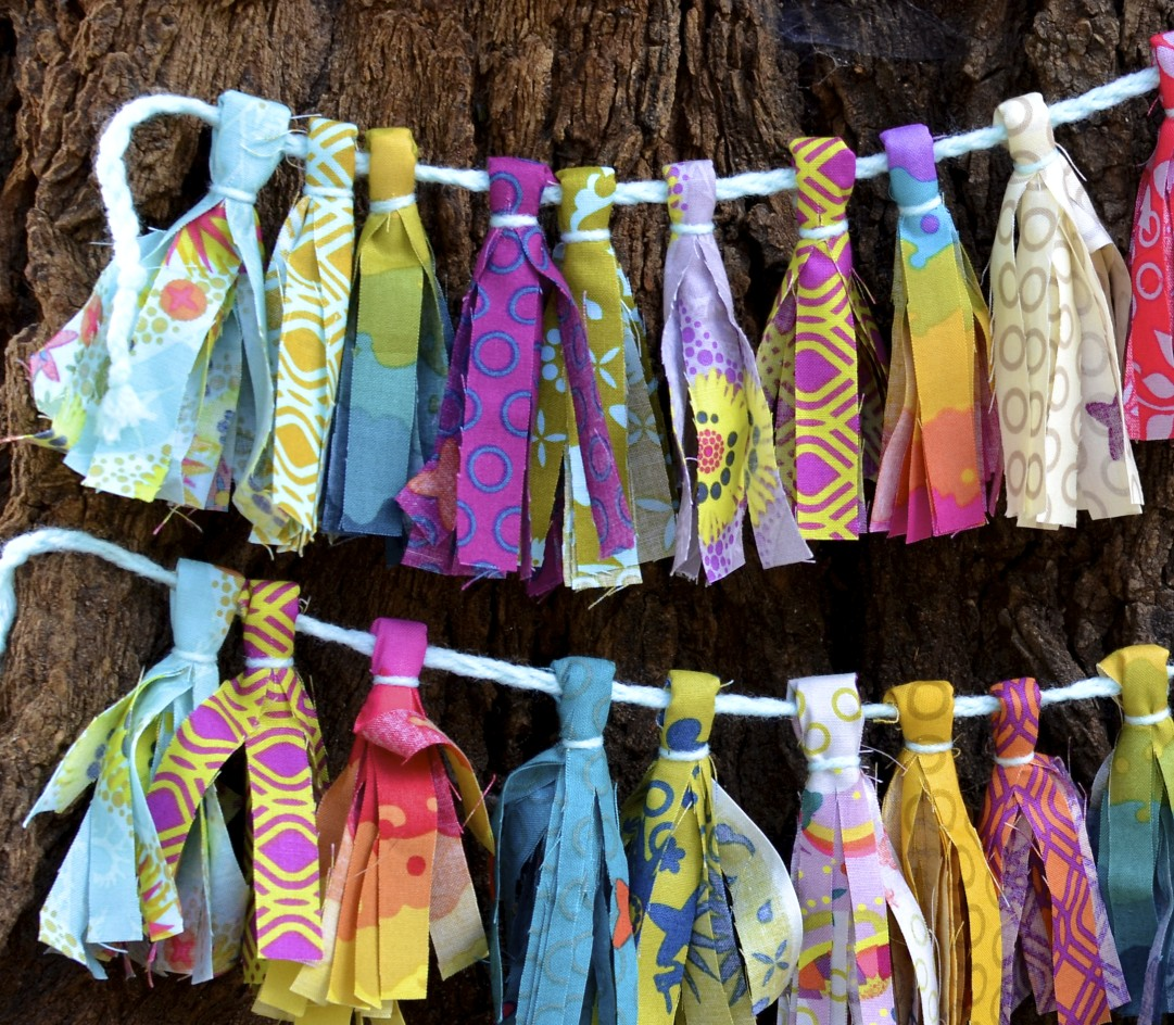 string each tassel onto a ribbon, yarn or string. that's it! so simple and fun and an excellent craft for little ones to help you with!