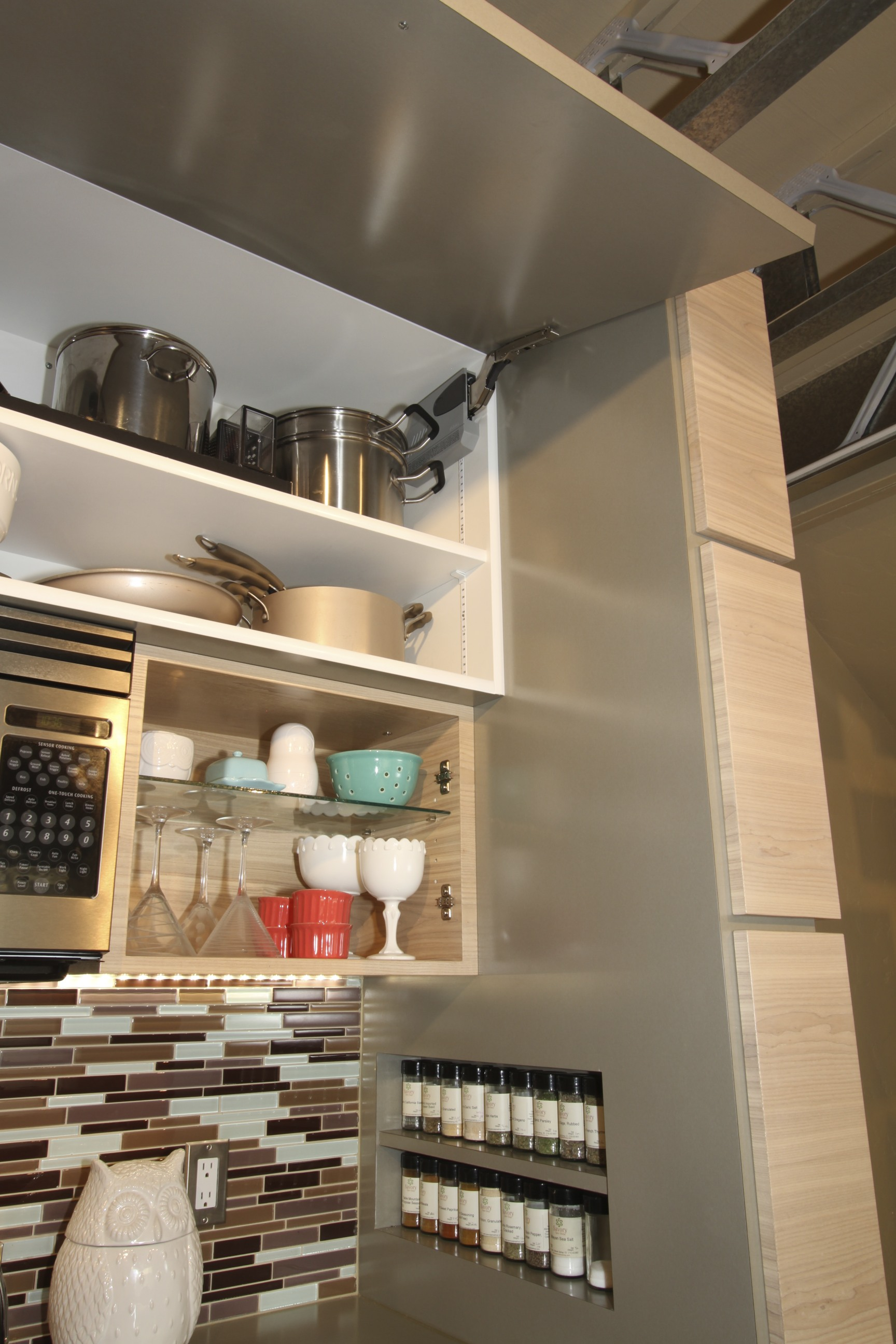 Built in spice shelves and lift up high storage