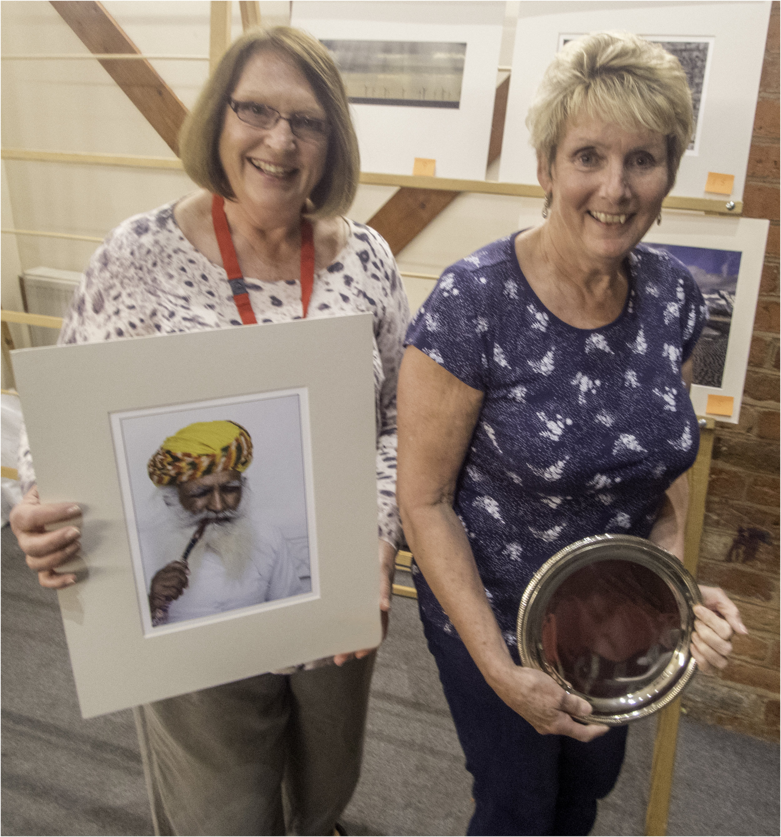 Sue Abbott being presented with her trophy by Chairman Barbara Turner for her winning Print (Standard Section) 'Hookah Smoker'