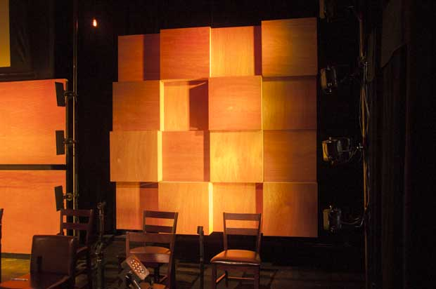 Here's the wall with light. Four Flat Par 7s hit each block wall from the side, about 4' downstage of the wall. ColorBlasts lit the panels on the back wall.