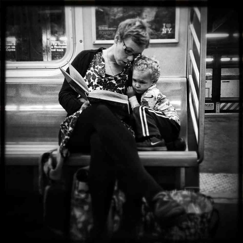 Jabali Sawicki/  @jsawicki1/Instagram  :   Original caption via Instagram:   #pscommute 5:15 PM on the C Train. 34th Street, Penn Station back home to Fort Greene, Brooklyn. Giving the gift of reading. A magical moment between mother and son. It may seem like just another subway ride, but with a book and an imagination, the adventures are limitless.