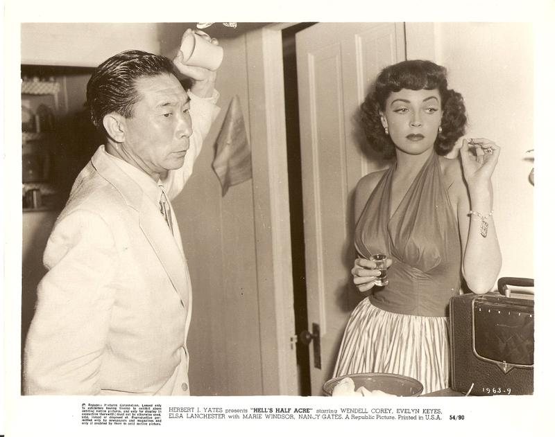 Roger Kong (Philip Ahn) and Rose Otis (Marie Windsor)