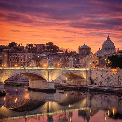#rome in #purple and #orange #stpeters #vatican #river #bridge #water #sky #clouds #skyline #travel #night #reflection #throwback