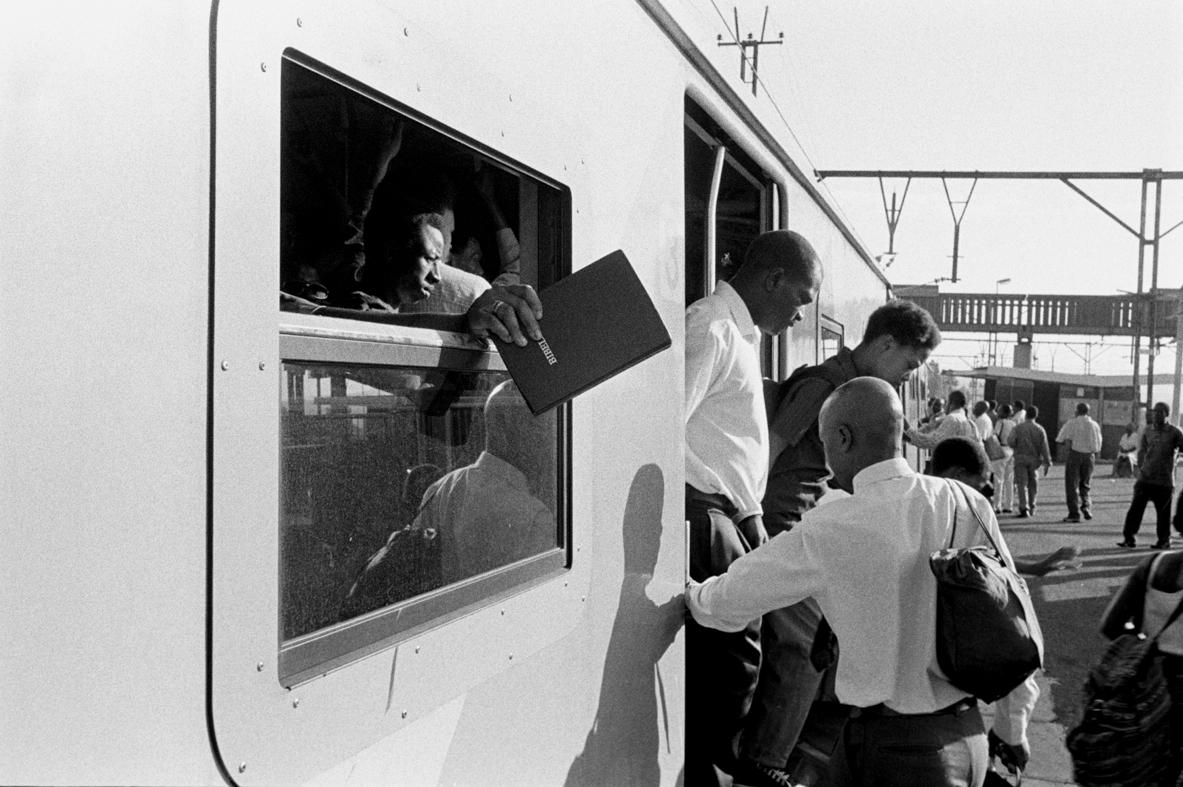 Rene Paul Savignan, Welcoming members to the train-church car 2002.jpg