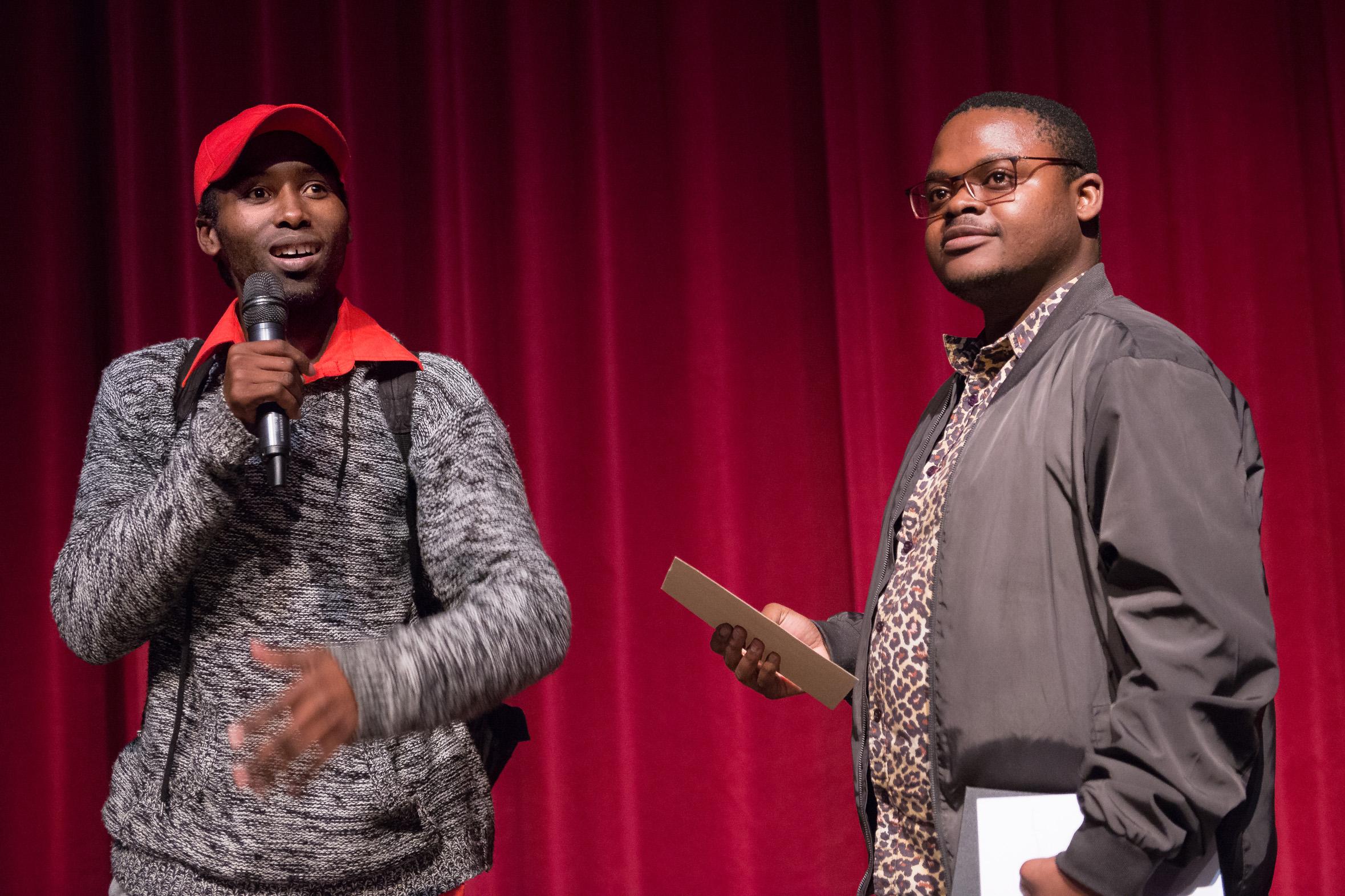 JC Zondi (left) receives the award from Chris Tobo.