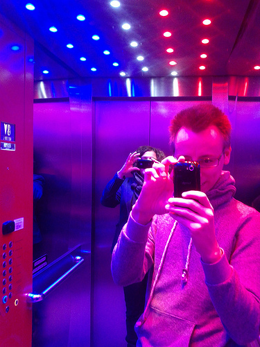 """Let's take photos of the funky elevator."""
