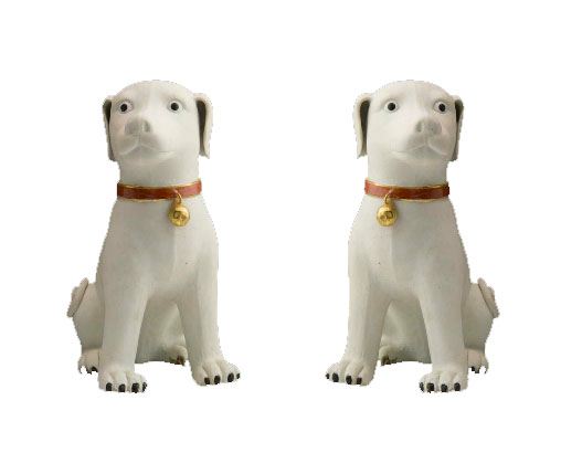 MC05- A fine and rare pair of seated white biscuit dogs