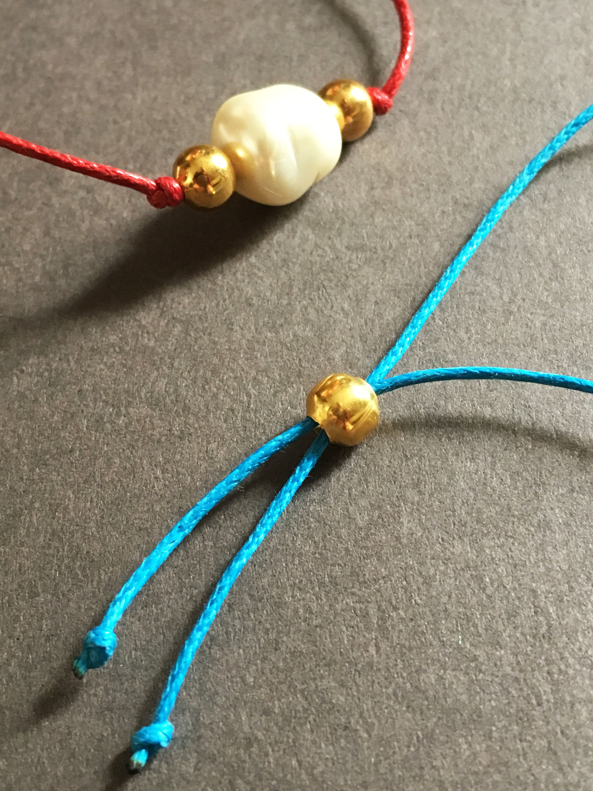 Red and blue cord bracelets.jpg