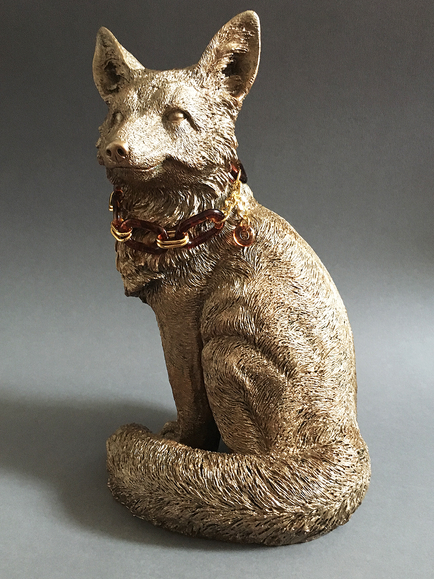 Fox sculpture in bronze finish.jpg