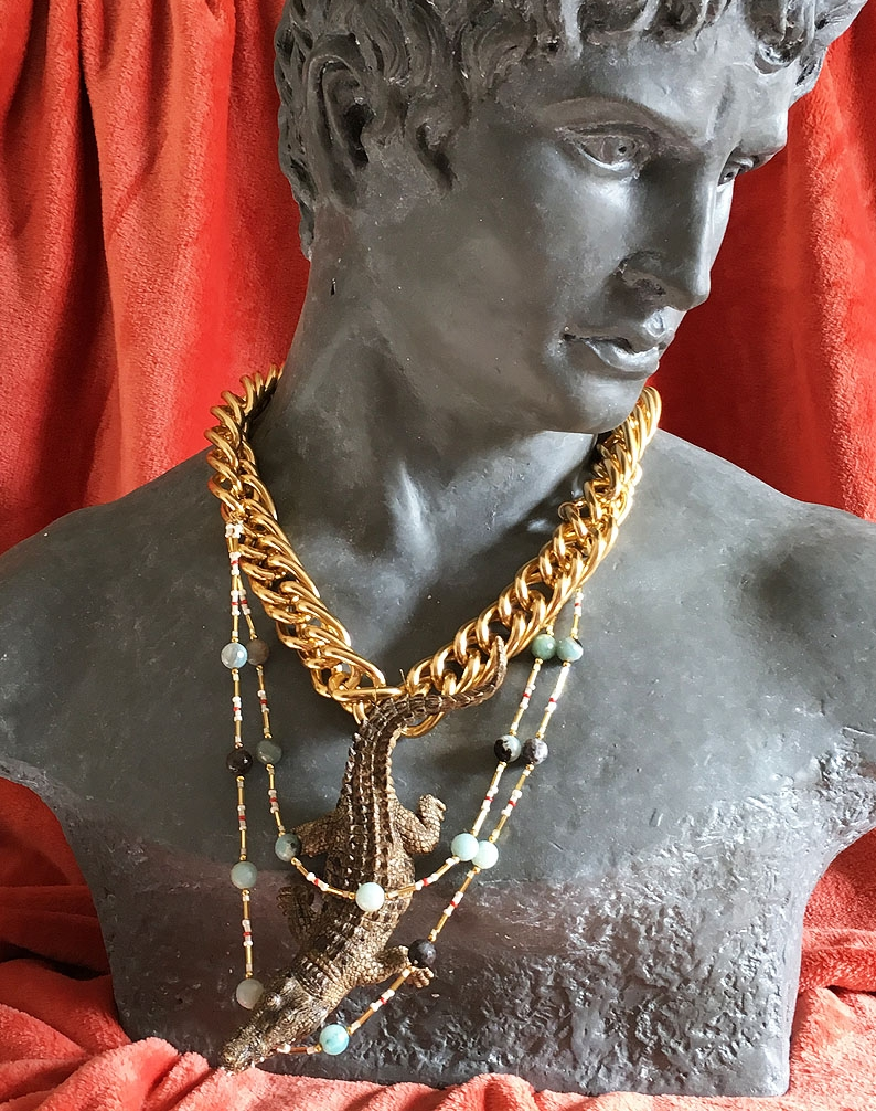 Necklace with crocodile figure and beads.jpg