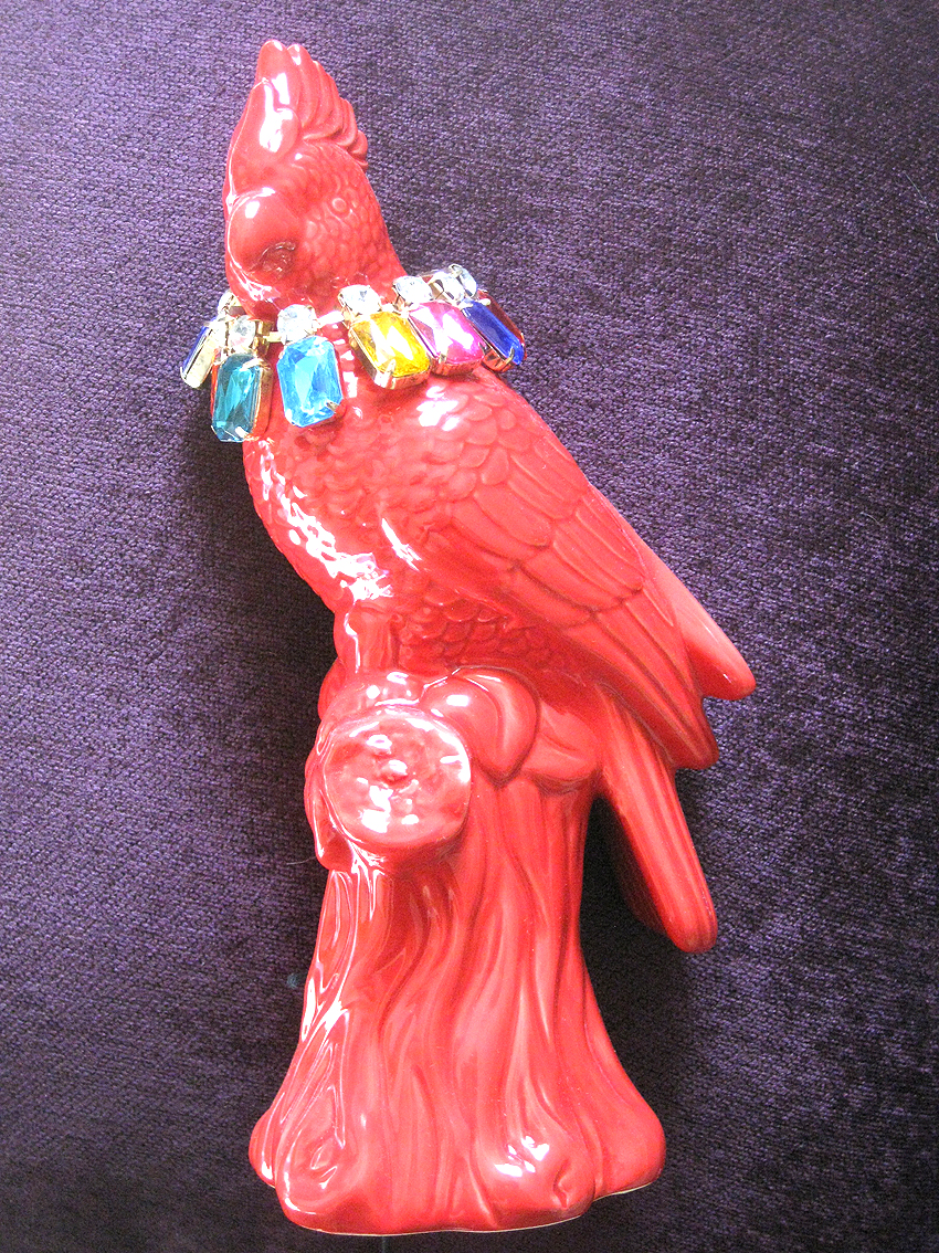red parrot with fabulous jewellery.JPG