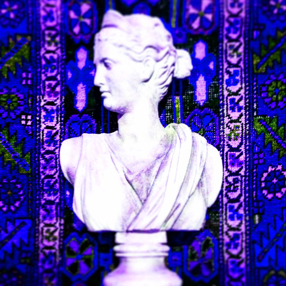 Photography and styling of an antique Roman bust against a background in a kilim print in shades of lilac and blue colours.  © styleART design studio